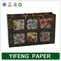 custom luxury carrier cheap paper shopping bag with OEM printing wholesale