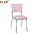 Pink vinyl seat and back metal chrome dining chair