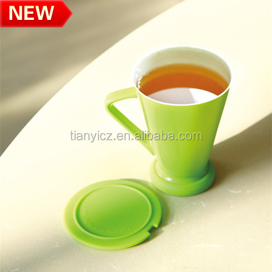 Popular color glazed ceramic office mug with silicon botton & tea infuser/strainer