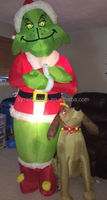 outdoor inflatable christmas grinch with Max dog