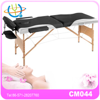 bicolorable sex massage table with carry case cream white and black color