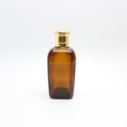 square 100ml amber glass bottle with the gold screw top S-52Z