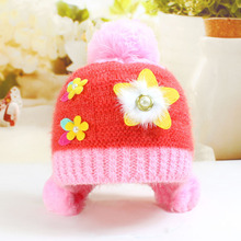 Wholesale winter selling hot five-pointed star super soft baby warm ear knit wool hat with flower