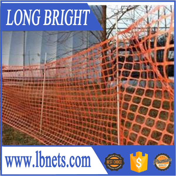 Yellow orange and other color plastic safety barrier fence mesh