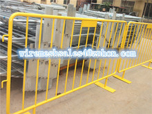 Yellow color crowd control barrier fence for Temporary road construction