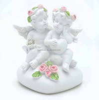 Double cupid sitting on heart shape stone resin angel statue