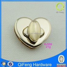 Heart shape turn lock lady design handbag twist lock with low price H-559