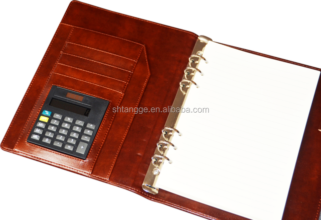 loose leaf diary with calculator and pen
