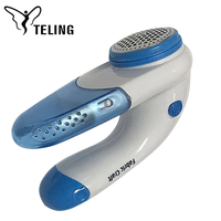Two battery electric clothes brush lint remover for pesonal use at home or travel