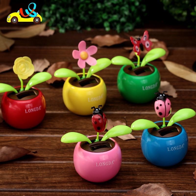 Hot sale cute cartoon type plastic promotion gift solar dancing 2 green-leaves flower design pot//