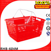 red plastic shopping basket with chromed