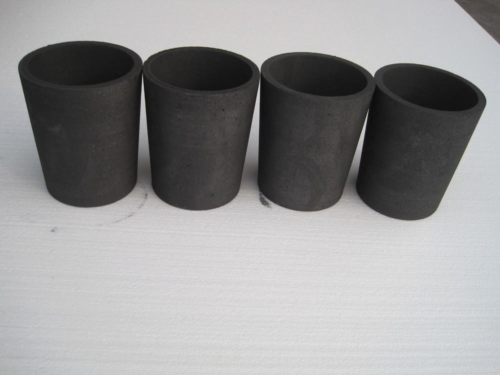 Graphite die and protective sleeve/cup for upcast copper machine