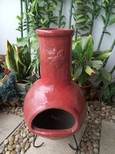 Sun Mexican clay chimenea in red