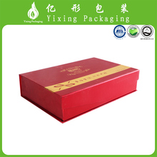 Red hard cardboard packaging gift box with foil logo and stain inside