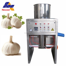 New design commercial galic peeling machine/30kg/h garlic skin peeler/garlic processing machine
