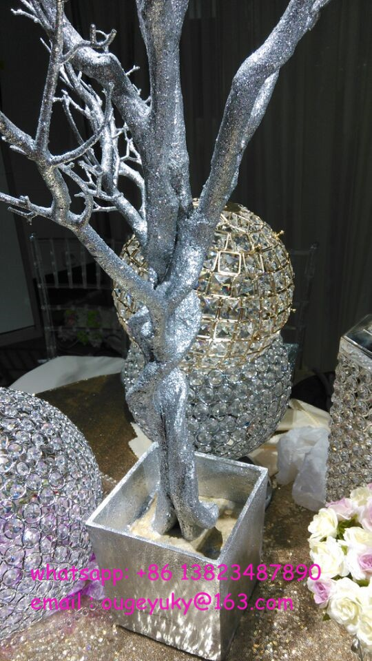 Silver glitter artificial tree branches wedding table