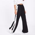 Loose black preppy style tape button side wide leg pants for women