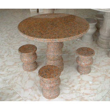 round stone dining table top and chair