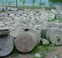antique limestone millstone
