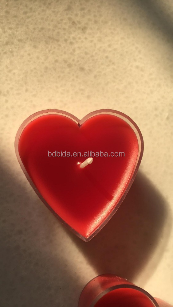 Red heart shaped tealight candle in plastic holder