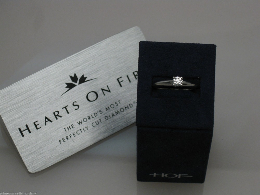 "HEARTS ON FIRE platinum ""INSIGNIA"" 4 engagement ringWITH center stone MTR760AAPl"