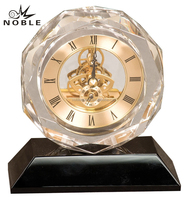 Hot Salling Round Diamond Edge Crystal Craft, Crystal Skeleton Gears Clock With Gold Face And Black Base.