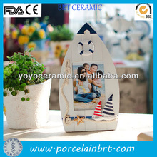 white and blue resin boat shape picture frame