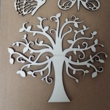 woodcut tree pendant decorating small tree