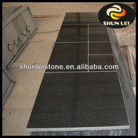 Black granite solid fuel fireplace hearth