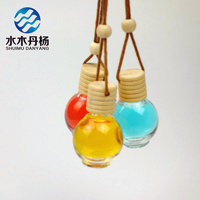 Wholesale 10ml round shaped car perfume glass bottle hanging car perfume bottles