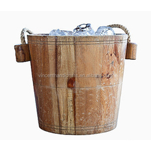 Rustic antique primitive wooden ice bucket with hemp rope handle for home or bar decor
