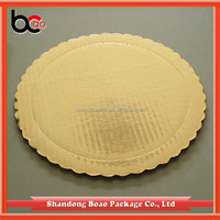 Die cut scalloped cardboard cake circle