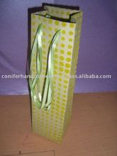 flock printed wine bottle bags with satin ribbon handles suitable for gifting and use by wine stores