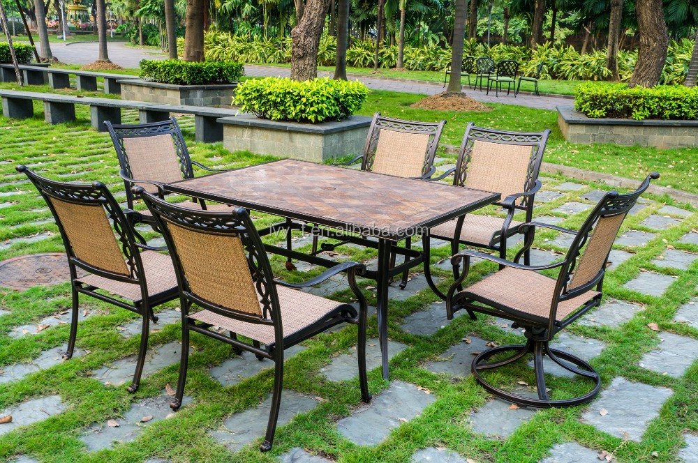 garden dining chair with ceramic table / patio dining swivel set in cast aluminum mental material with sling fabric