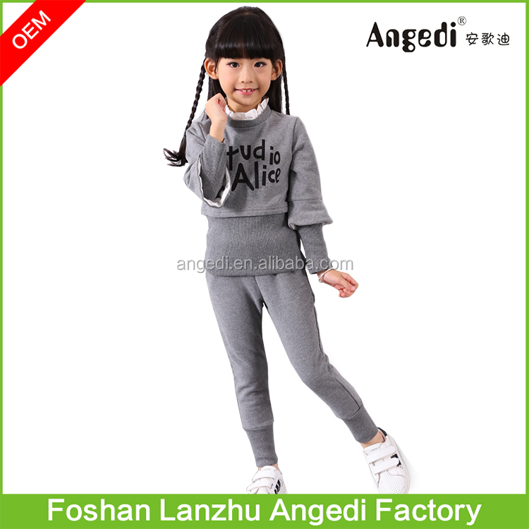Sports design child wear wholesale kids wear china with tops and pants hot selling girls clothing sets