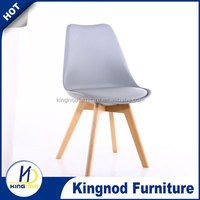 Modern cheap tulip dining chair replica pu cushion chair wooden legs PP plastic chair