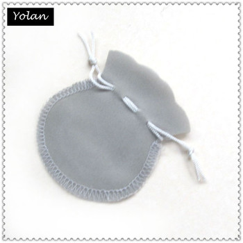 Grey velvet bag for packaging gifts with company brand