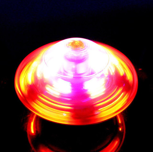 Musical plastic gyro electric spinning top,flashing peg top toy with light