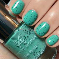 A textured, speckle-effect nail polish laced with black matte specks. 10ml light green nail varnish made in USA