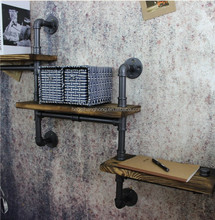 pipe book shelf with black cast iron pipe