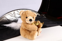 brown angel bear with violin