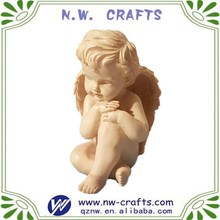 Vivid small pondering baby angel sculpture for decor