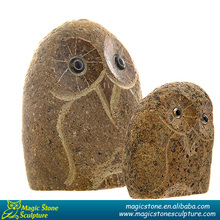 small sculpture stone owls
