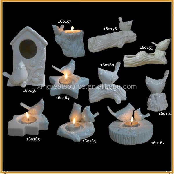 small ceramic white birds figurines with tealight