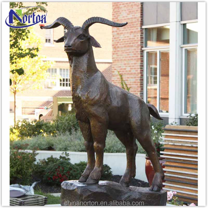 Modern life size goat bronze sculpture in the mountains NTBA-017Y