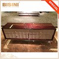 Modern Stylish Imported Leather Door Living Room Cabinet, Wood Veneer Top and Rose Gold Plated Brass Legs Floor Cabinet