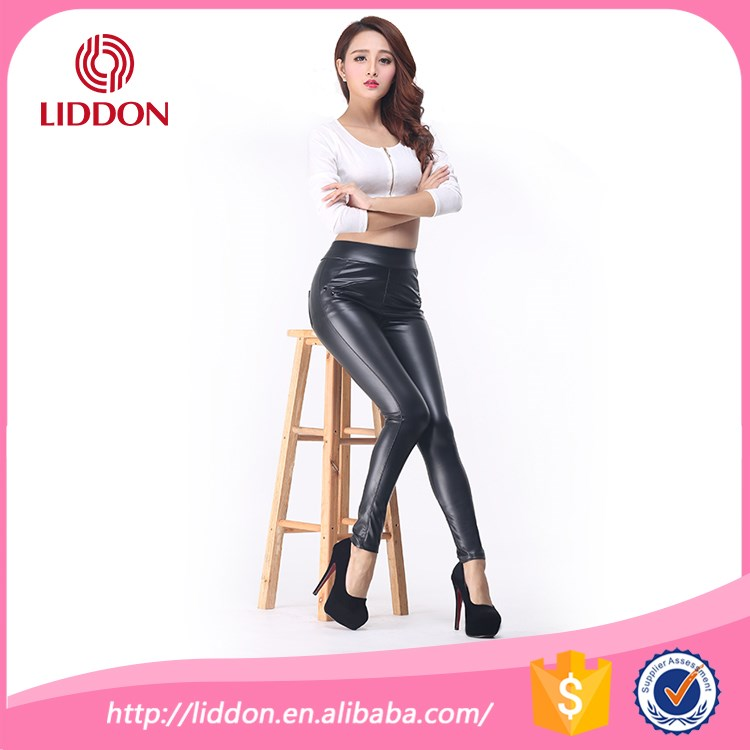 Punk rave party girl and boy wearing ultra shiny pantyhose stretch PU leather pants xxxl leggings