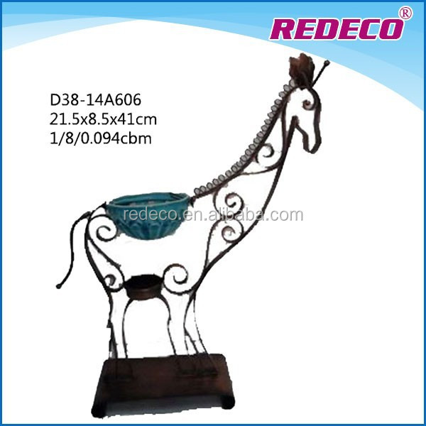 Decorative metal giraffe sculpture with candle holder