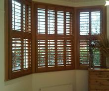 sliding interior faux wood shutters For bathroom