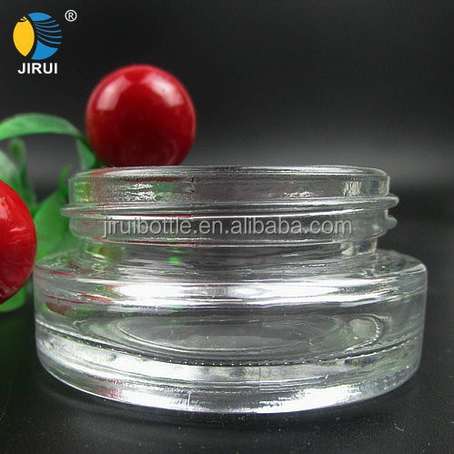 small clear empty circle glass cosmetic cream jar with cap